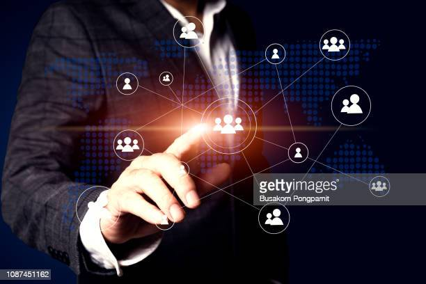 businessman touching global network and data customer connection - people icons stock pictures, royalty-free photos & images