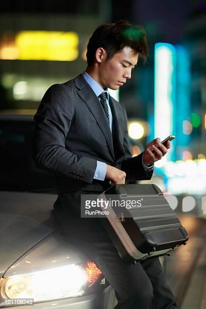 businessman touching mobile phone,night scene