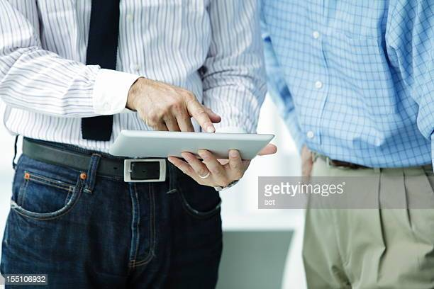businessman touching on digital tablet,close up - abbigliamento da lavoro formale foto e immagini stock