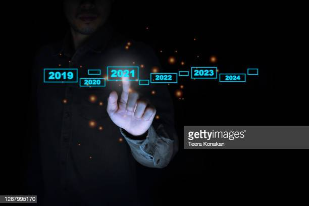 businessman touching on virtual screen 2020-2021. welcome year 2021 concept - 2019 2020 calendar stock pictures, royalty-free photos & images