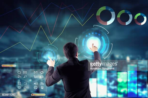 Businessman touching presentation on graphical technology screens