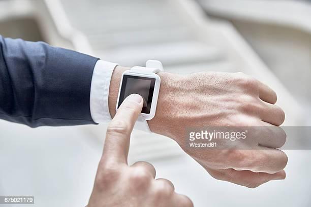 Businessman touching smartwatch