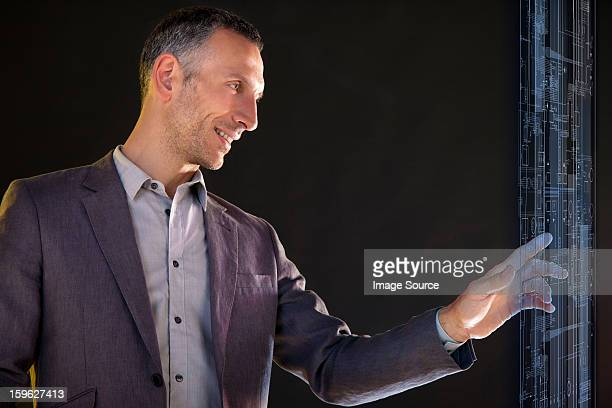 Businessman touching virtual information