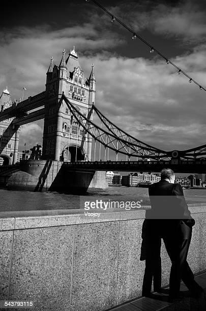 businessman, tower bridge, london - vsojoy stock pictures, royalty-free photos & images