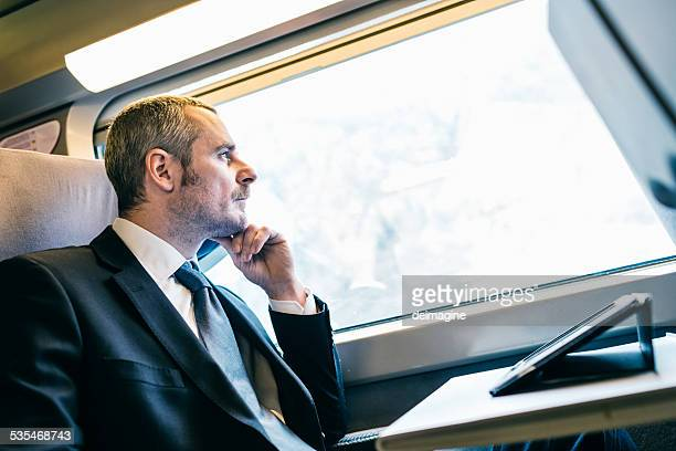 Businessman train travelers