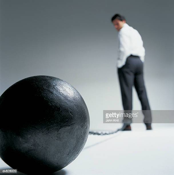 Businessman Trapped By Ball and Chain