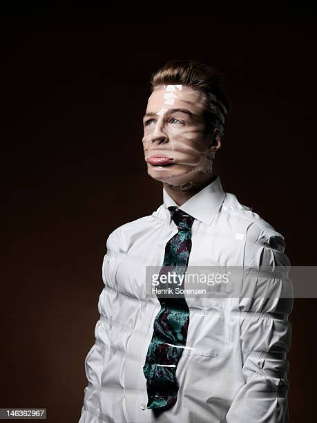 businessman trapped by tape