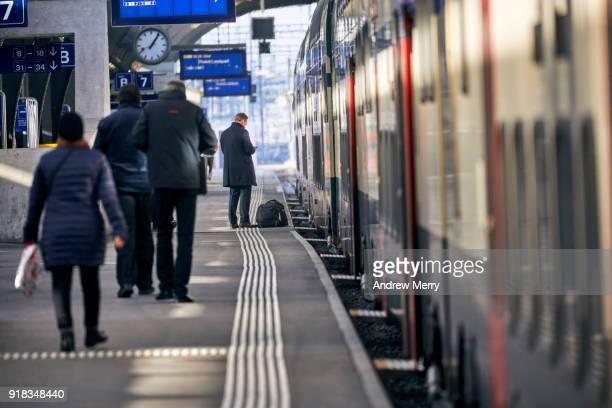 Businessman, traveler on platform waiting for a train at Zurich Central Station