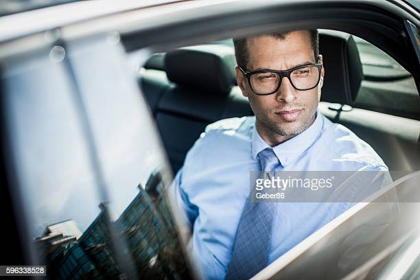 Businessman traveling in a car