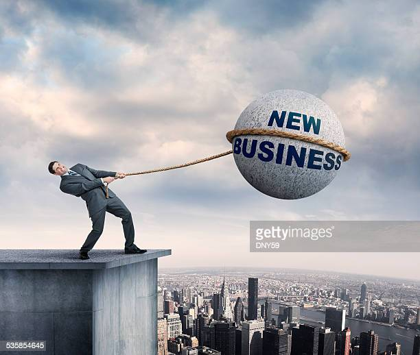businessman trying to rope new business - man with big balls stock photos and pictures