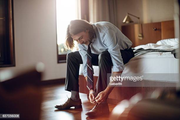 businessman tying his shoe laces - tied up stock pictures, royalty-free photos & images