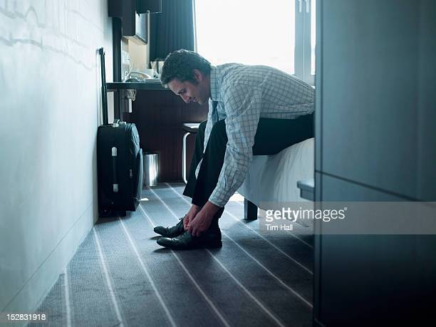 businessman tying his shoes - work shoe stock photos and pictures