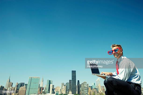 Businessman Types by Skyline with Heart Glasses