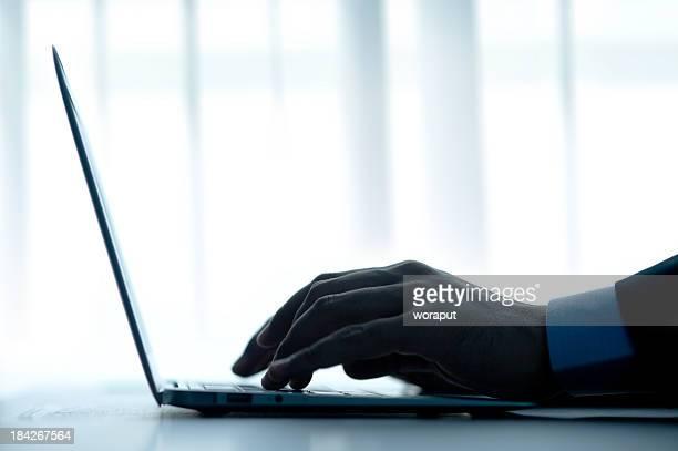 Businessman typing a computer.