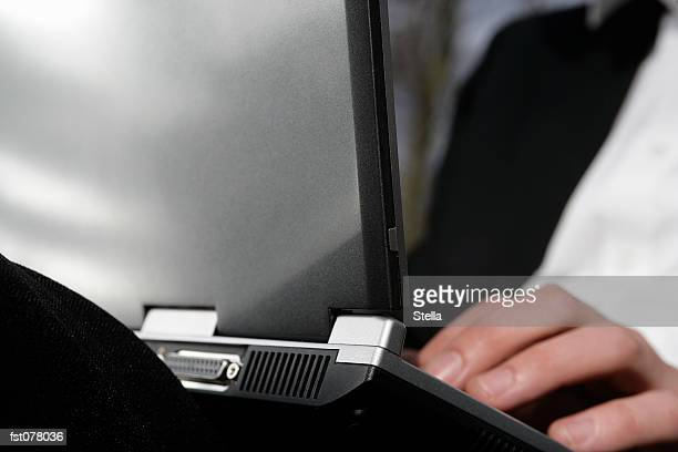 a businessman typing on a laptop computer - datorport bildbanksfoton och bilder