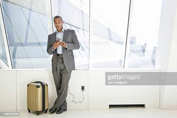 Businessman typing on mobile phone