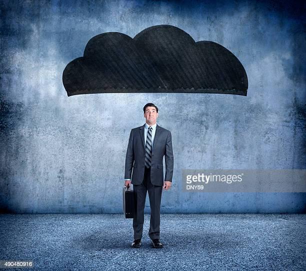 Businessman Under A Dark Cloud