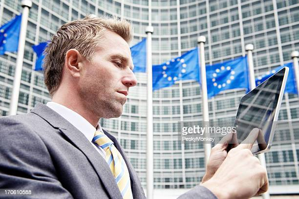 Businessman Uses Digital Tablet Computer at European Commission Brussels
