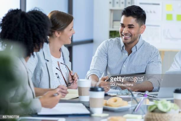 Businessman uses digital tablet during meeting