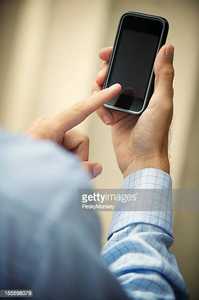 Businessman Uses Smartphone with Blank Screen Outdoors