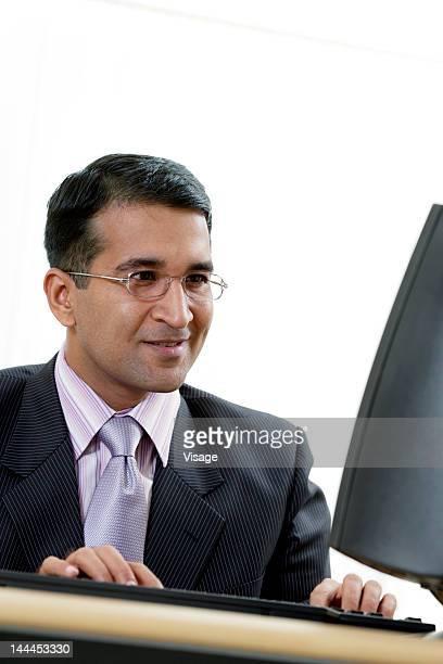 A businessman using a computer
