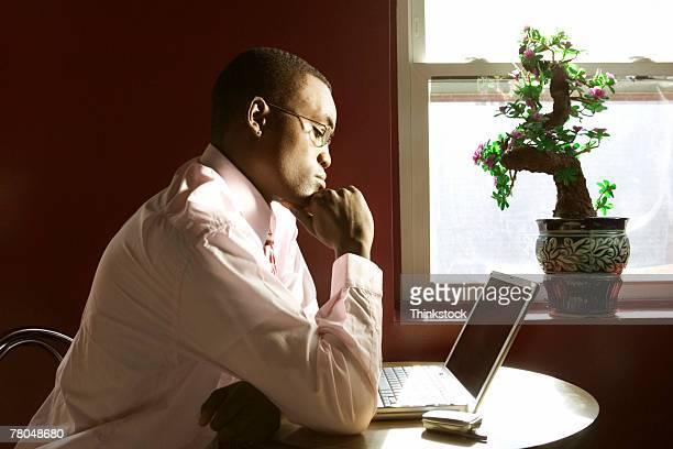 businessman using a computer - thinkstock stock-fotos und bilder