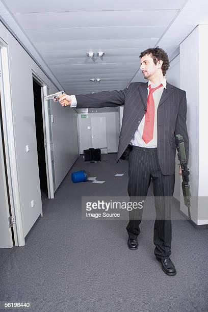 Businessman using a handgun