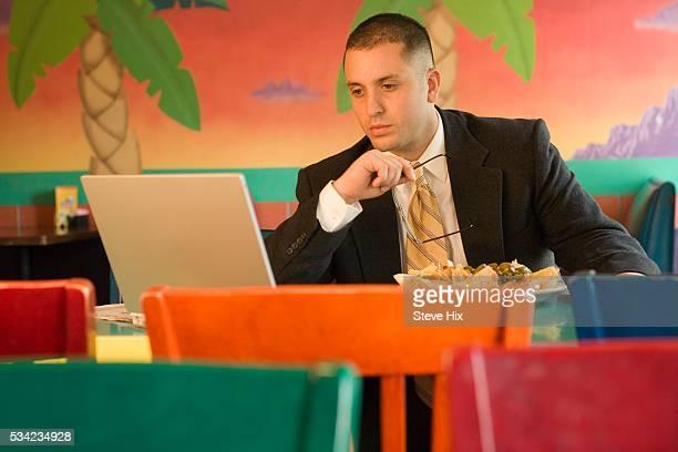 Businessman Using a Laptop Computer in a Restaurant