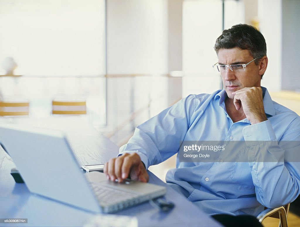 businessman using a laptop in an office : Stock Photo