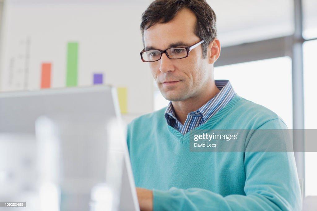 Businessman using a laptop : Foto de stock