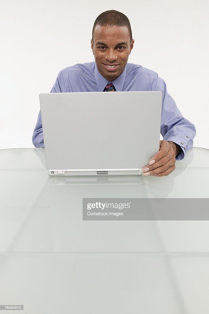 Businessman using a laptop : Stockfoto