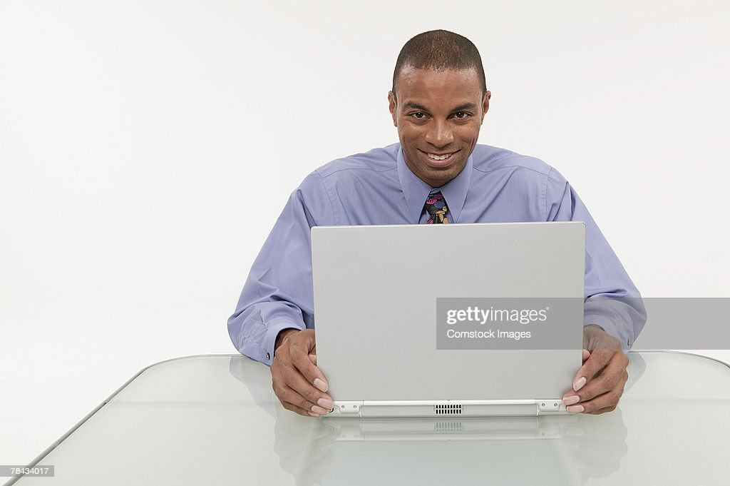 Businessman using a laptop : Stockfoto