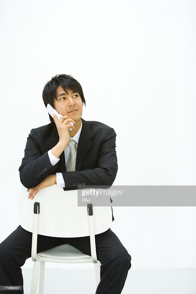 Businessman Using a Mobile Phone, Front View, Copy Space  : Photo
