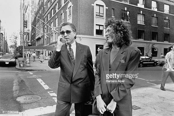 A businessman using a mobile phone on the street in New York City 1991