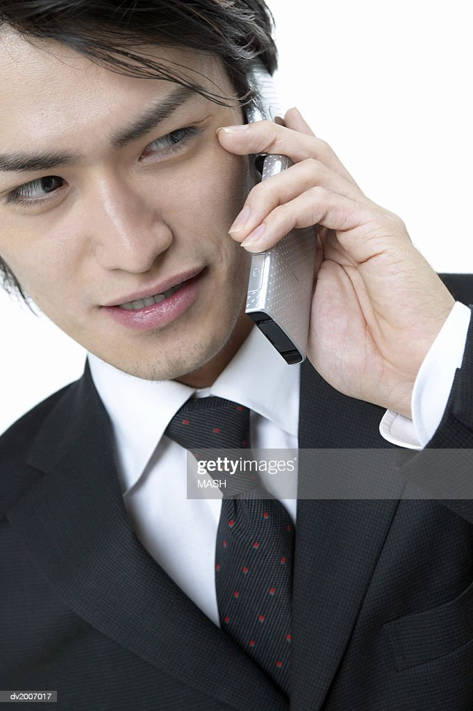 Businessman Using a Mobile Phone : Stock Photo