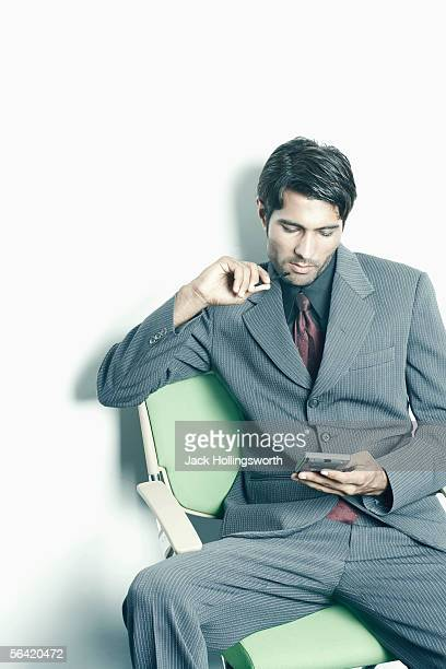 Businessman using a personal data assistant