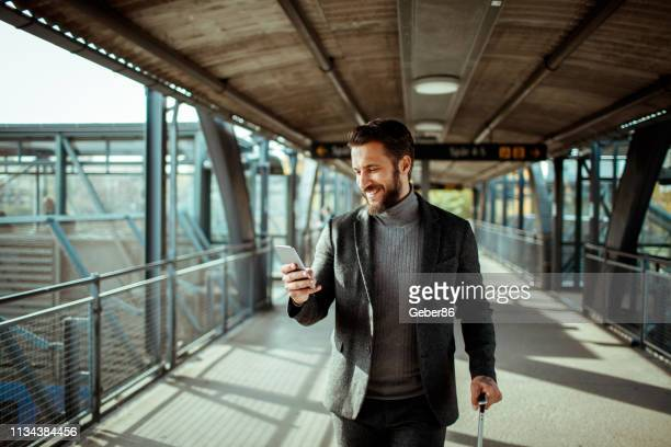 businessman using a phone - business travel stock pictures, royalty-free photos & images
