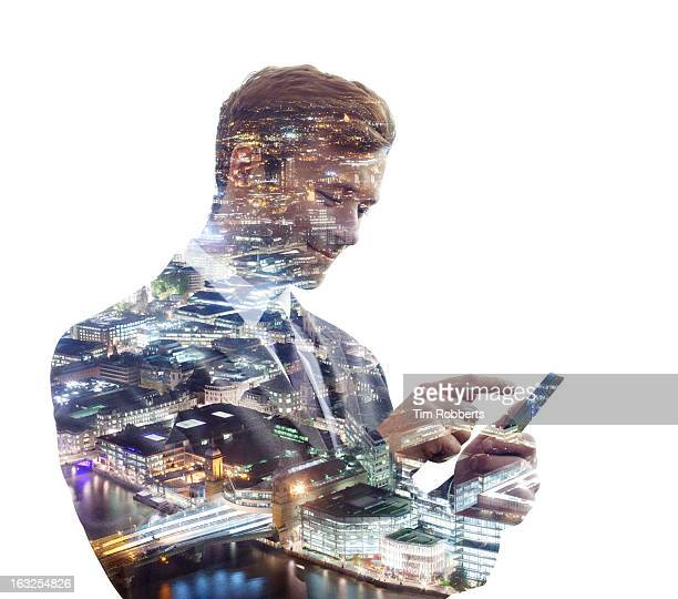 Businessman using a phone, with city at night