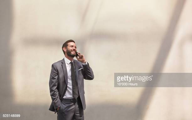 Businessman using a smartphone and smiling