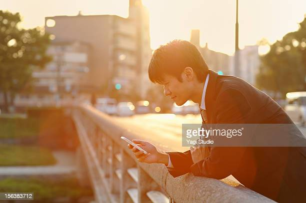 Businessman using a smartphone in city