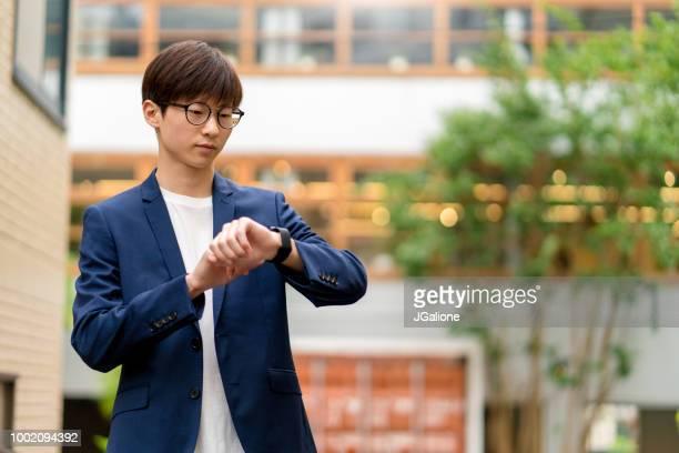 Businessman using a smartwatch