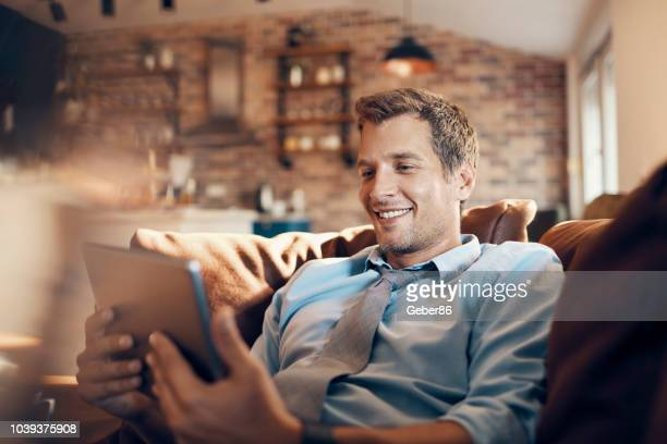 businessman using a tablet - solo 2018 film stock pictures, royalty-free photos & images