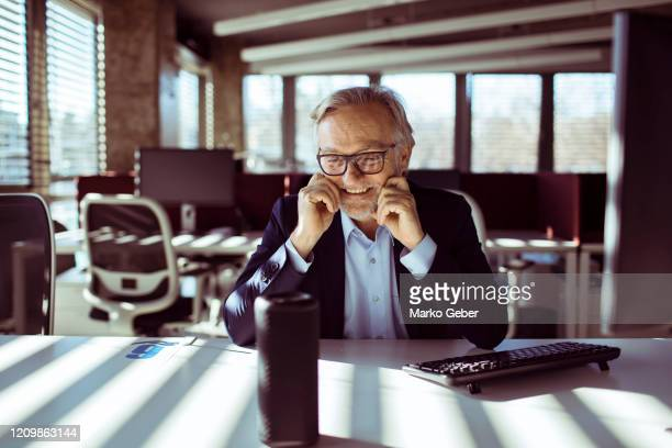 businessman using a virtual assistant - ai stock pictures, royalty-free photos & images
