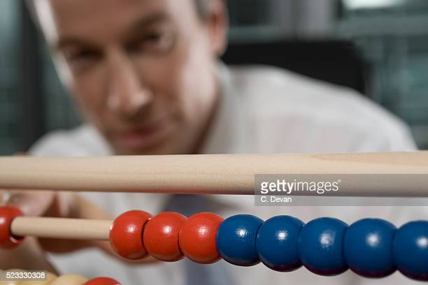 Businessman Using Abacus