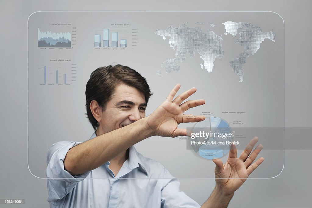 Businessman using advanced touch screen technology to view sales data : Stock Photo