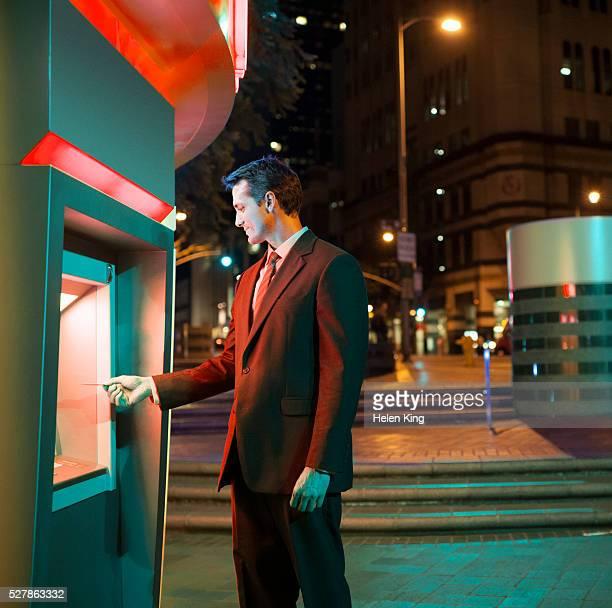 Businessman using ATM