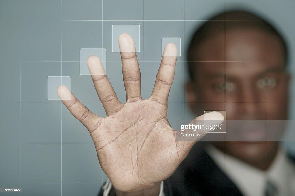 Businessman using biometric technology : Stock Photo