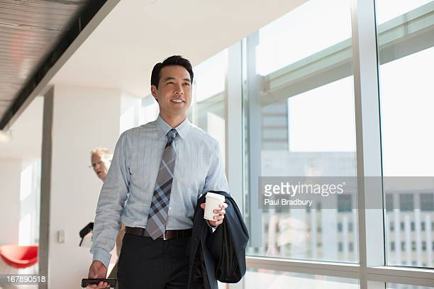 businessman using cell phone in office - one mid adult man only stock pictures, royalty-free photos & images