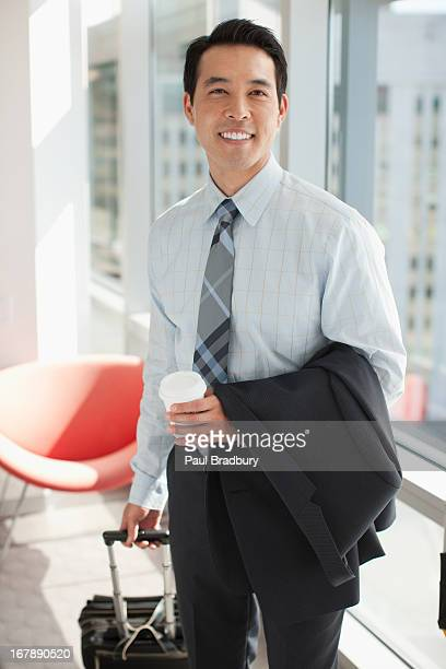 携帯電話を使用して実業家のオフィス