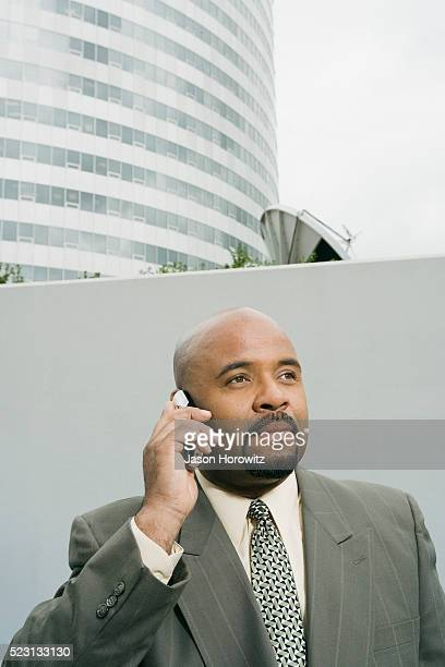 Businessman Using Cell Phone Outside